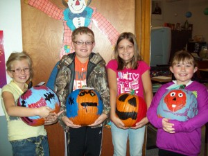 3rd graders with pumpkins they decorated to be sold at Leevers