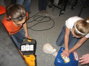 Students practicing CPR with AED.