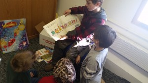 Jack reading to Jacob Selvig, Braden, and Jacob Selensky