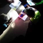Kindergarten class reading in the dark