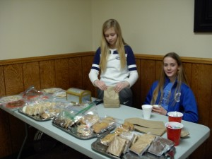 girls selling baked goods